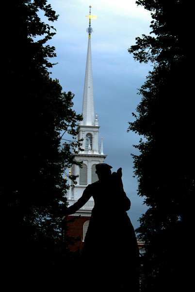 Paul Revere statue silhouetted in front of the Old North Church, where the signal lanterns were hung to signal his famous ride.