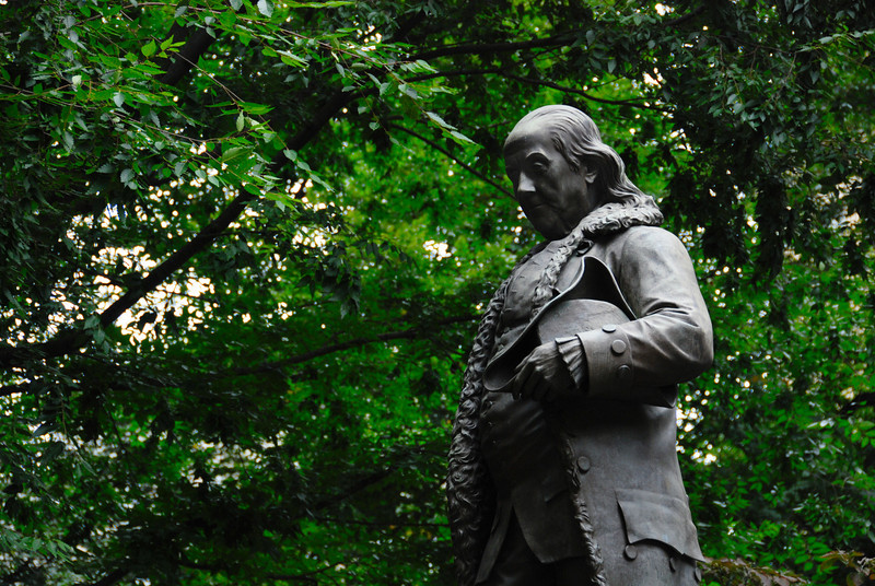 Statue of Benjamin Franklin near the site of the first public school in America. Franklin did attend, but dropped out.