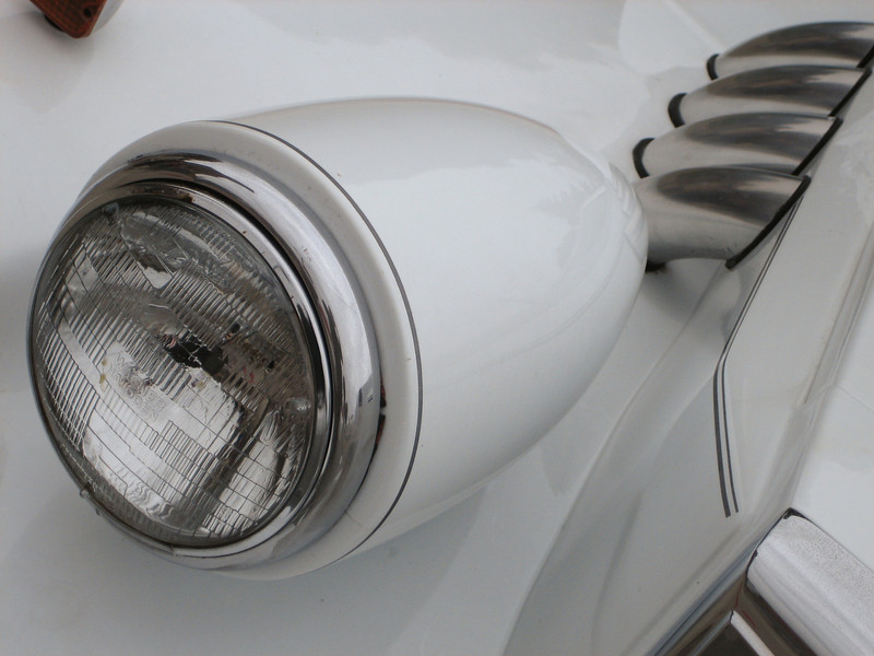 Headlight of the old and classy Lincoln that drove the bride and groom to the reception.