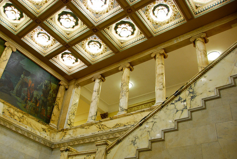 Inside the MA State House, featuring a lot of elaborate marble and lighting.
