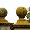 Moss-covered balls (not sure what the architectural term for big concrete balls is...) at the Breakers mansion.
