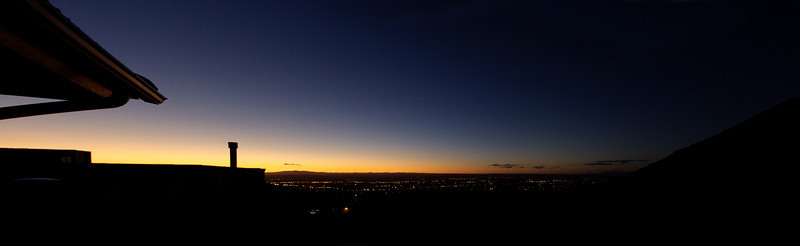 sunset from the spencers' place.  the lights of albuquerque are laid out below.