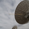 At the VLA (Very Large Array) scientist search outer-space for other galaxies, super novas with 82 foot diameter radio-telescopes.
