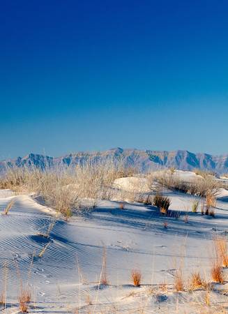 San Andres Mountains in the background. White Sands National Monument, Windblown gypsum drifts shape the landscape.