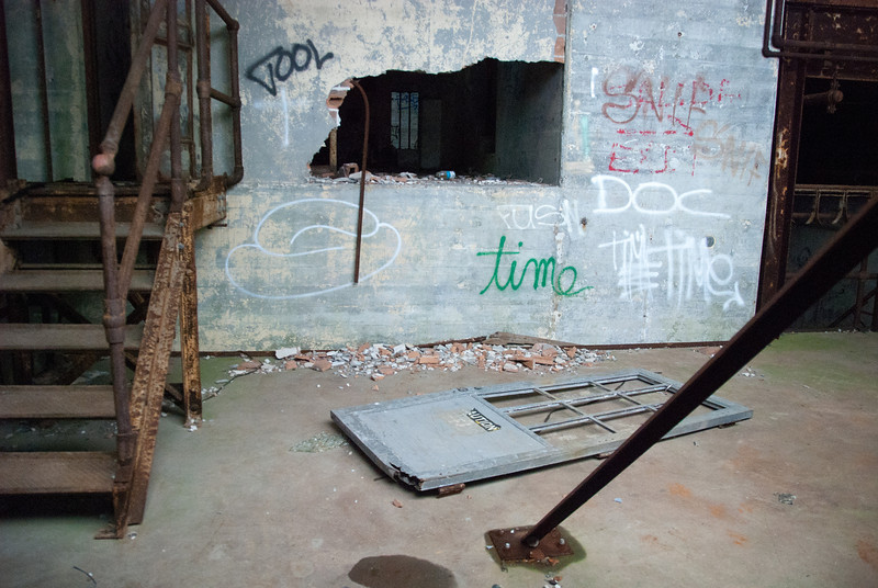 """<span id=""""title"""">Abandoned Power Plant</span> <em>New Orleans</em> For this shot, I had to take the lens off the camera to fit it through a fence. I don't think they did any cleanup after Katrina, they just sealed it off."""