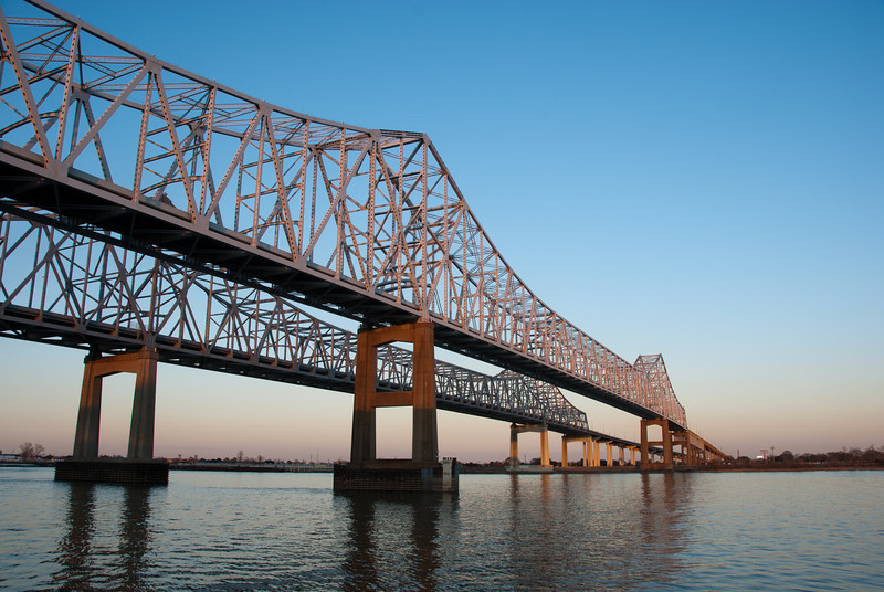 """<span id=""""title"""">Bridge at Sunset</span> <em>Crescent City Connection</em> The main bridge that takes cars from one side of the Mississippi to the other. The next closest bridge is over 10 miles upstream. There are no bridges downstream."""
