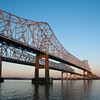 "<span id=""title"">Bridge at Sunset</span> <em>Crescent City Connection</em> The main bridge that takes cars from one side of the Mississippi to the other. The next closest bridge is over 10 miles upstream. There are no bridges downstream."