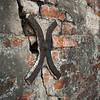 "<span id=""title"">Anchor</span> <em>St. Louis Cemetery No. 2</em> I'm not sure, but I'm guessing this is an anchor to hold the brick wall in place. I saw several others on the old walls surrounding the cemetery."