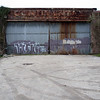 """<span id=""""title"""">Garage</span> <em>New Orleans</em> One of many confusing rusted signs I saw."""