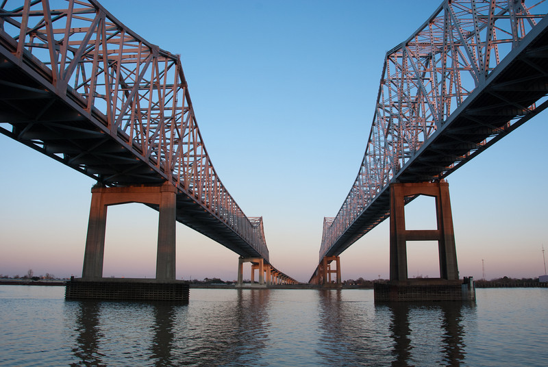 """<span id=""""title"""">Bridge at Sunset</span> <em>Crescent City Connection</em> One final image of the bridge that Wikipedia calls the Crescent City Connection - the primary bridge over the Mississippi in New Orleans. One reason the bridge needs to be so high is for the freight ships that travel up the river. When I was there I was worried a cruise ship was going to get in my photo, but it ended up performing and impressive 3-point turn (or 5 or 7) and heading out to the gulf."""