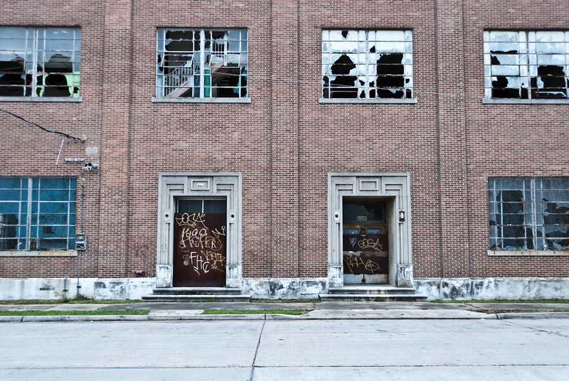 "<span id=""title"">Abandoned Power Plant</span> <em>New Orleans</em> Most of the lower level windows are broken and huge steel plates have been welded over the doorways."