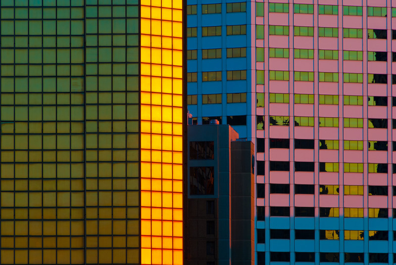"""<span id=""""title"""">Sunrise Colors</span> <em>New Orleans</em> The colors are exaggerated a bit, but this was the scene on some skyscrapers from our hotel roof at sunrise."""