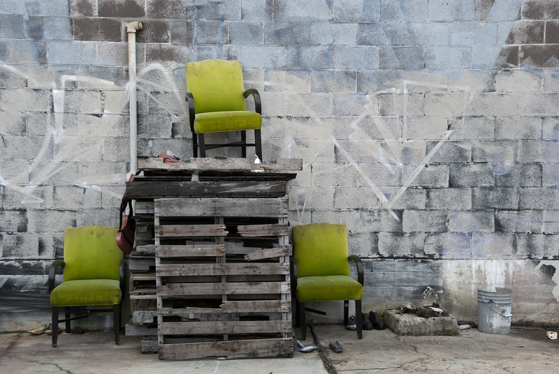 """<span id=""""title"""">Three Green Chairs</span> <em>New Orleans</em> This area looked like an empty homeless camp at first, but now I'm not sure. This was a pretty random scene, though."""