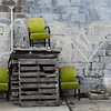 "<span id=""title"">Three Green Chairs</span> <em>New Orleans</em> This area looked like an empty homeless camp at first, but now I'm not sure. This was a pretty random scene, though."
