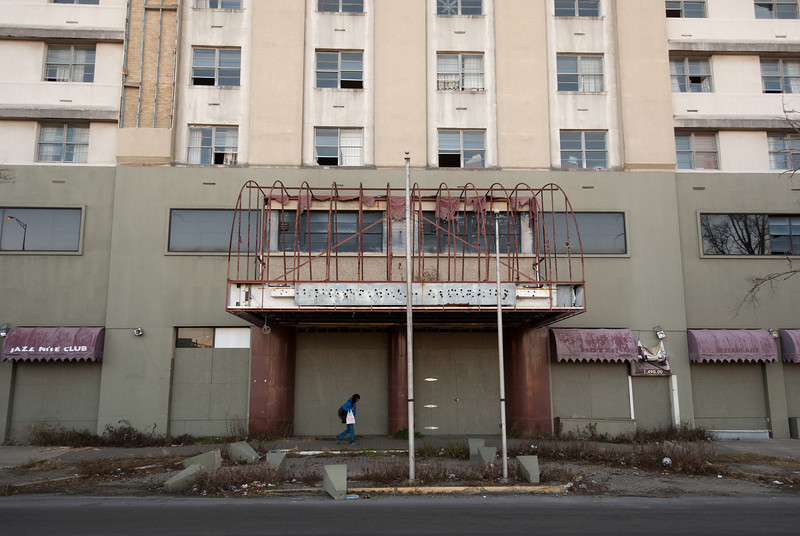 """<span id=""""title"""">Grand Palace Hotel</span> <em>New Orleans</em> Not so grand anymore... This shell of a hotel is right at Canal Street and I-10, and it was probably a nice hotel - it even had a jazz nite club! Now it's a depressing 20-story reminder of Katrina. What I don't understand is that while searching for info on the hotel, I saw reviews for it as recently as 2010. I can't see how this is an operating hotel that people could stay in - they must keep the entrance pretty hidden. It looked completely abandoned to me."""