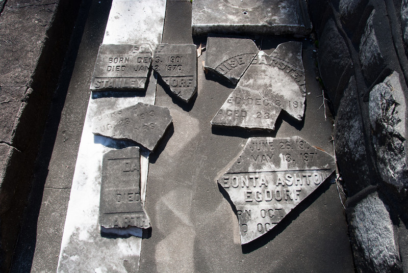 "<span id=""title"">Broken</span> <em>Lafayette Cemetery No. 1</em> Looks like someone has tried to put the pieces back together, but they're missing a few."
