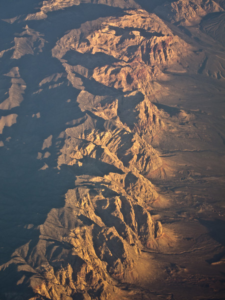"<span id=""title"">Sandstone Reefs</span> <em>Flight from LAX to STL</em> This red rock, made redder by the sunrise is in the Spring Mountains, West of Las Vegas."