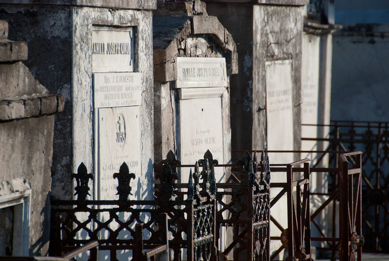"""<span id=""""title"""">Fences</span> <em>St. Louis Cemetery No. 2</em> A big difference between this cemetery and Lafayette No. 1 is that most of these tombs have fences surrounding them. At Lafayette you could wander in between them pretty freely."""