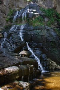 Frontenac Falls, located within Camp Barton, a Boy Scout camp on the west side of Cayuga Lake, just north of Taughannock Falls State Park in Trumansburg, NY
