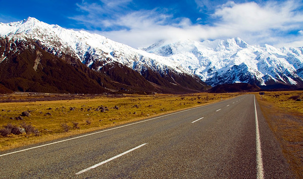 The road leading up the Tasman River to Mount Cook New Zealands highest peak.