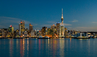 Auckland's destinctive skyline reflects in the Waitamata Harbour at Sunset