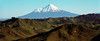 Mt Taranaki viewed accross the rugged hills of New Zealand's central North Island.