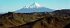 Mt Taranaki viewed accross the rugged hills of New Zealand's central North Island.