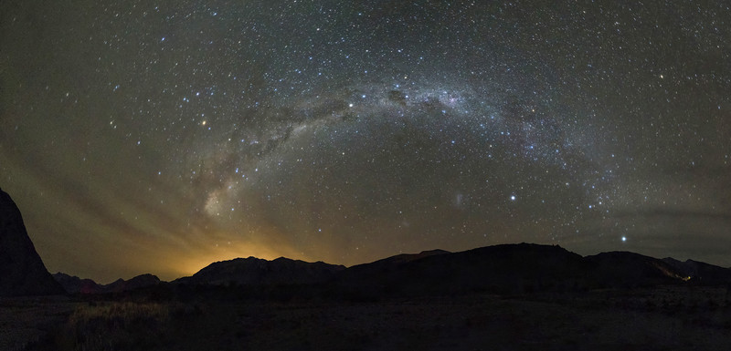 Panoramic view of the Milky way from Arthur's Pass. The yellow light glowing on the left is light pollution emanating from distant Christchurch, 90km away as the crow flies.