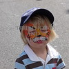 A boy with face painted during a street fair in Newcastle in New South Wales, Australia.