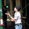 A boy juggles the balls during a street fair in Newcastle in New South Wales, Australia.