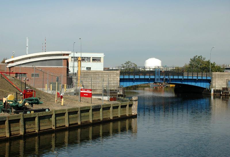 Metropolitan Ave Bridge and rowboat.