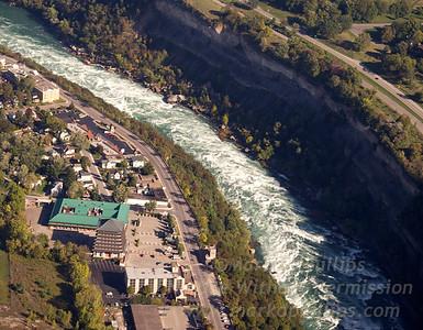 Niagara Falls rapids below the falls looking at Canada and the Niagara Parks Commission