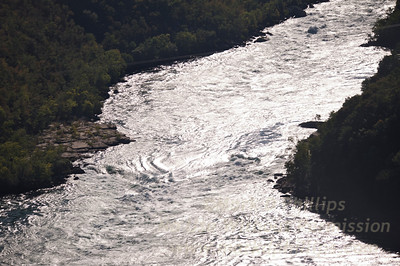 Niagara Falls, rapids, looking in gorge below falls.