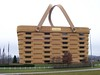 160 times the size of their regular medium market basket, it's made from steel, stucco and wood harvested & grown by the company itself.