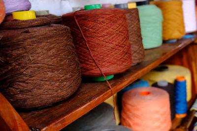 """Earthy"" colored spools of yarn."