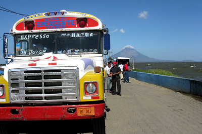 Not quite as colorful as Guatemala's buses, but close. Volcan Concepción, one of the two volcanoes on Isla Ometepe, rises in the distance.