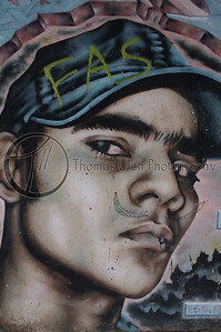 Graffiti on the wall outside UCA.  Managua, Nicaragua.
