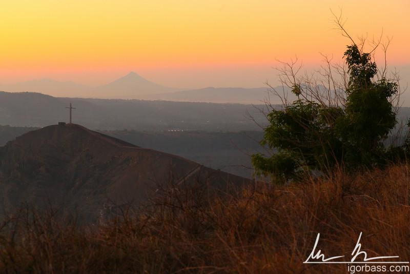 Hiking up Nindiri crater, sunset view back towards Cruz de Bobadila, Masaya Volcano National Park