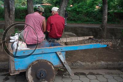 Two working men having lunch. Masaya, Nicaragua.