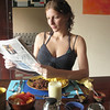 "Pretending to read ""La Prensa"" before digging into our B&B's yummy breakfast."