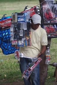 """What do you need?"" A street vendor in Managua. Managua, Nicaragua."