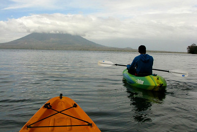 Guide Nolan leads the way, with Volcan Concepcion in the distance.