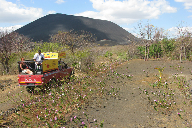 Volcano boarding! Our group of 17 arrived in two pickup trucks like this one. The volcano, Cerro Negro, looms in the background.