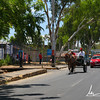 Street traffic in Managua: a horse drawn cart, a taxi and a chicken bus