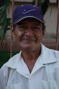 This fellow was hanging out with the two fellows in the two previous photos. They were all laughing and joking and smiling, very friendly. They stopped me to ask me if I needed directions or help and then of course they had their photos taken. He was the only one of the three that smiled! Masaya, Nicaragua.