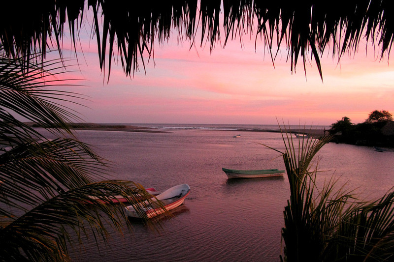 Post-sunset pink over the lagoon, from the thatched-roof lookout of our hotel