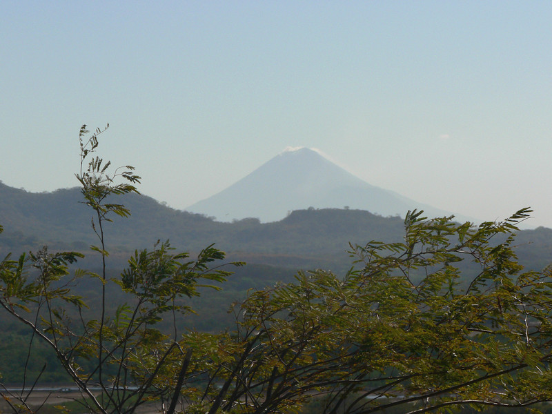 Telephoto shot of volcan San Christobal (I believe that is it)  in the distance.