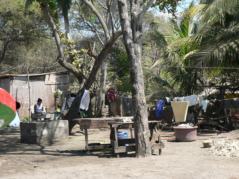 Life in Jiquilillo.  The outdoor kitchen and washroom of one of the locals.  Her husband is probably out fishing.