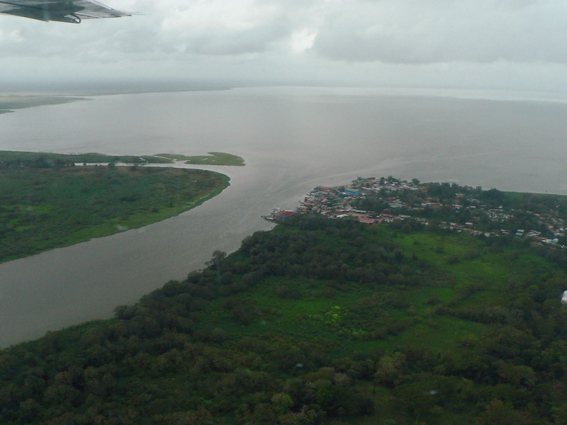 The next day, I flew by myself to San Carlos, to explore the Rio San Juan area.  <br /> Frm the air this is San Carlos, and the origin of the Rio San Juan In the southeast side of Lago de Nicaragua.