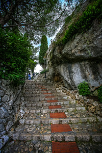 """Èze has been described as an """"eagle's nest"""" because of its location overlooking a high cliff 427 metres (1,401 ft) above sea level on the French Mediterranean."""